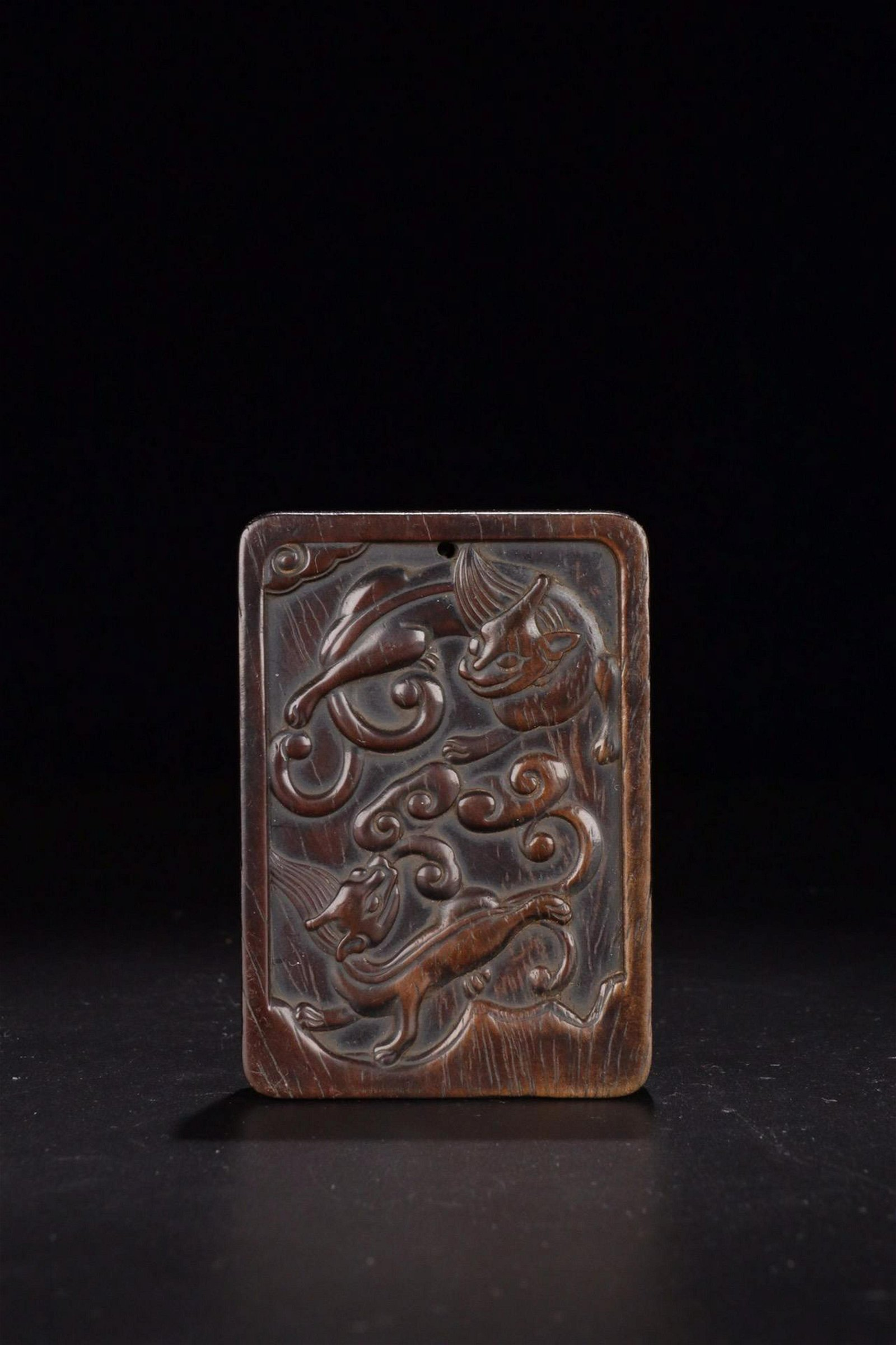 A XITAN WOOD CARVED TIGER PATTERN TABLET