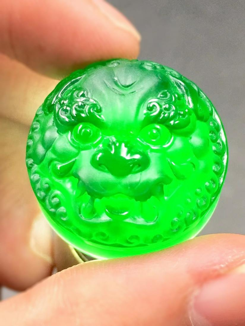 A BLACK AND GREEN JADEITE CARVED