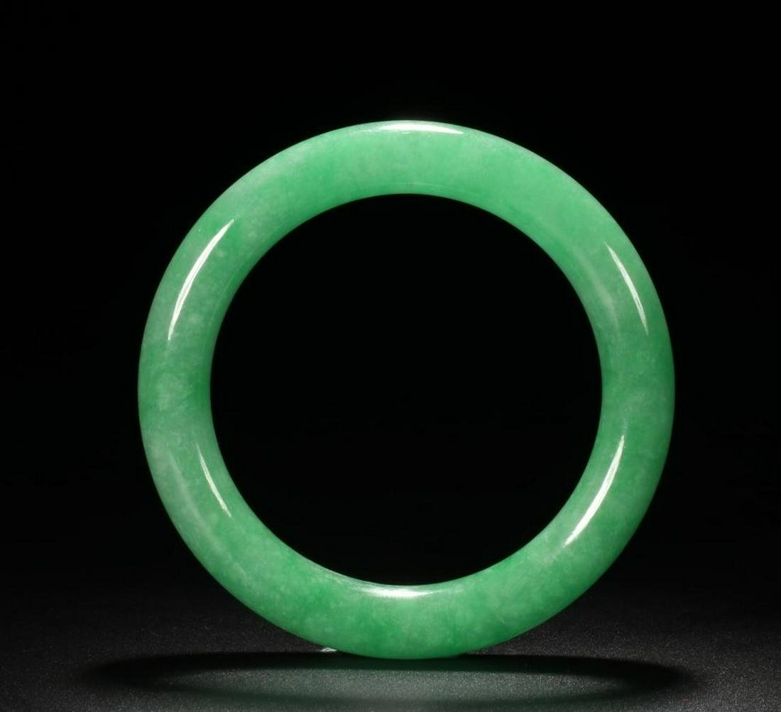 A JADEITE GREEN BANGLE