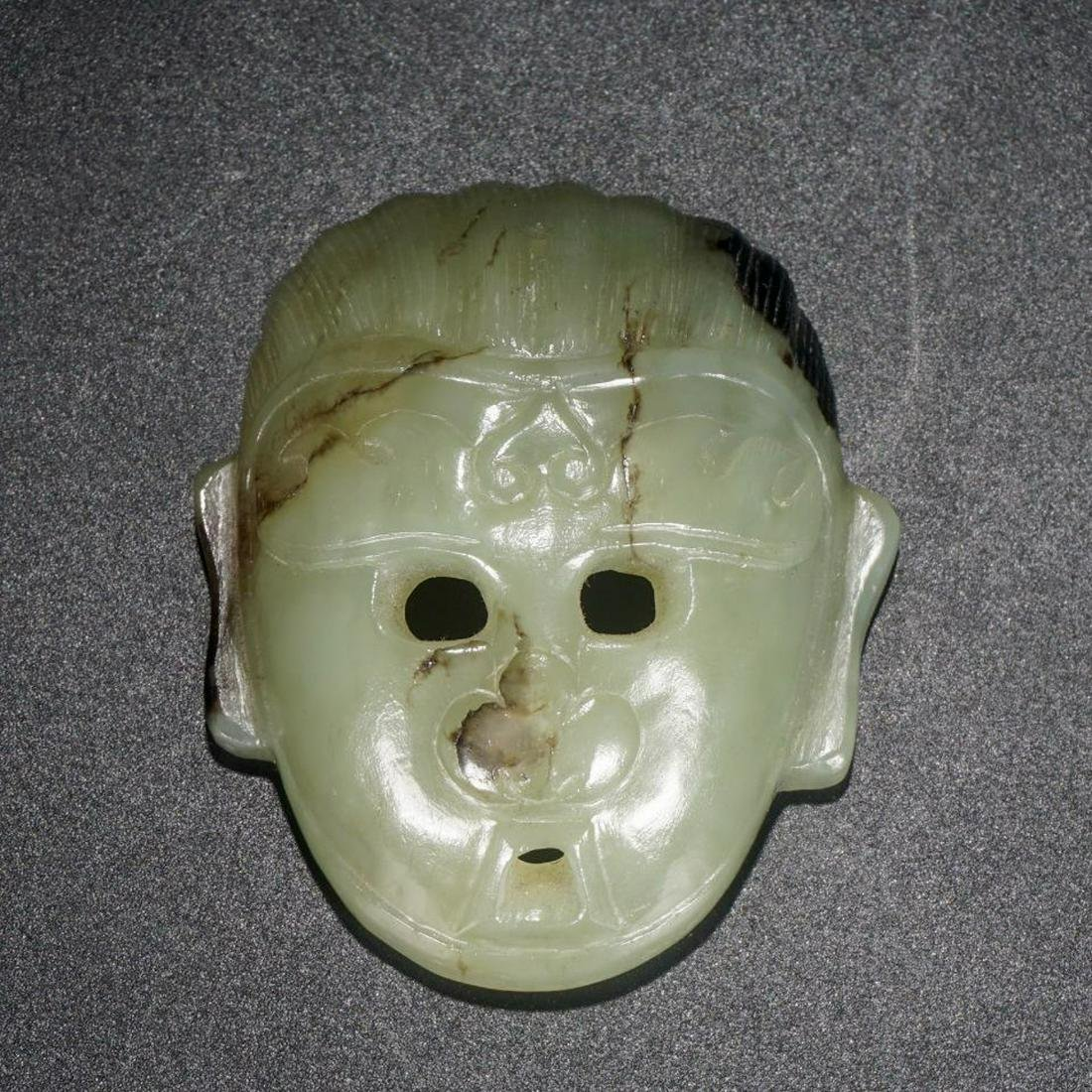 A OLD HETIAN JADE PENDANT WITH FACE SHAPED