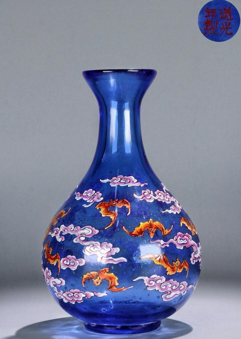A GLASS CARVED VASE