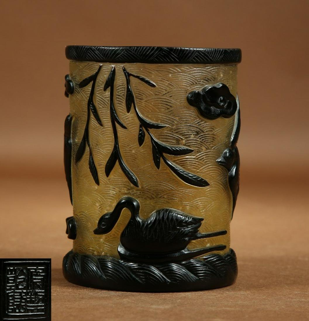 A GLASS BRUSH POT CARVED WITH BIRD PATTERN