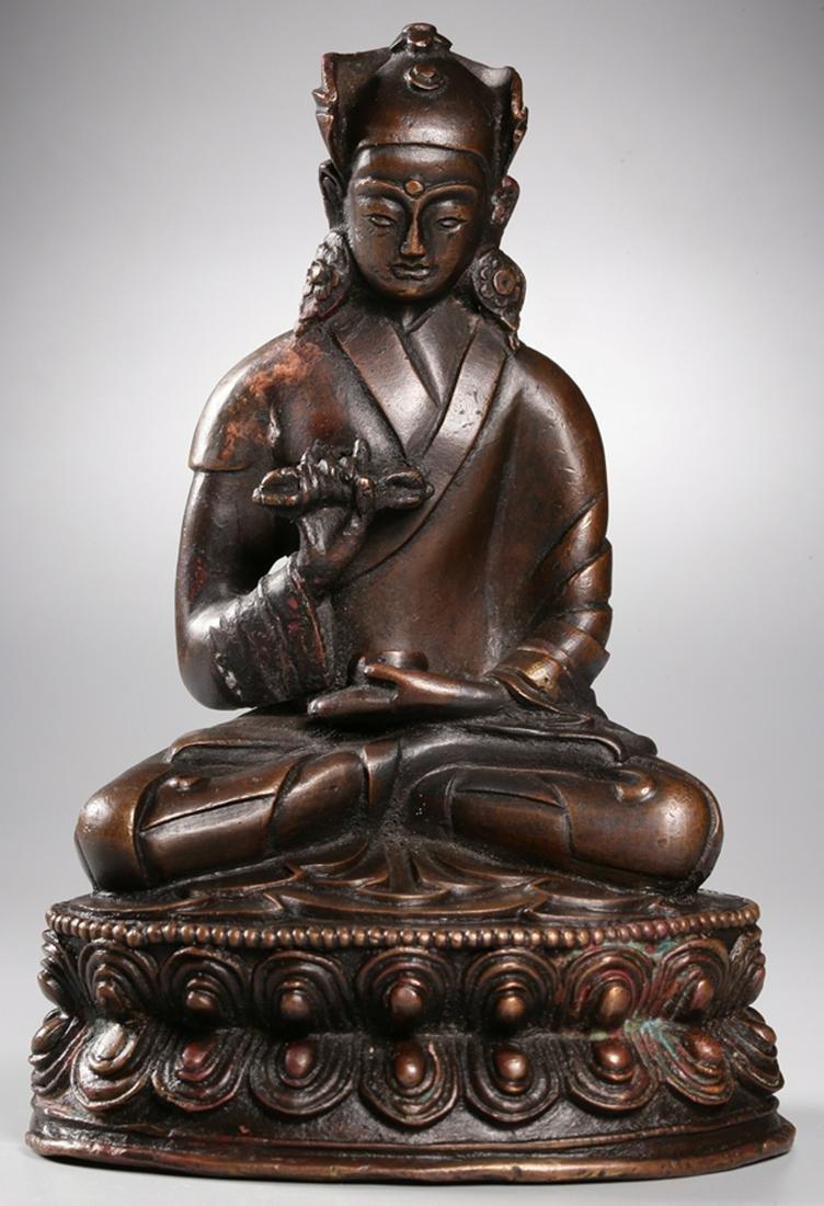 A COPPER CAST TIBETAN BUDDHA STATUE