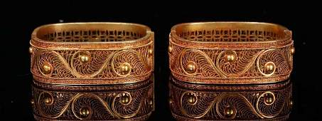 PAIR OF GILT SILVER FILIGREE BANGLES