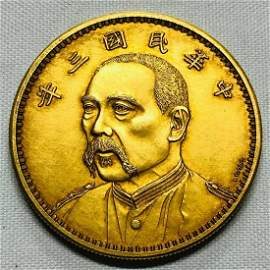 GOLD CAST FIGURE PATTERN COIN