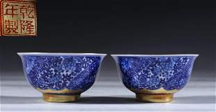 PAIR OF BLUE&WHITE GLAZE WITH GILT DECORATED CUPS