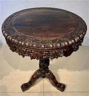 RED WOOD CARVED ROUND TABLE