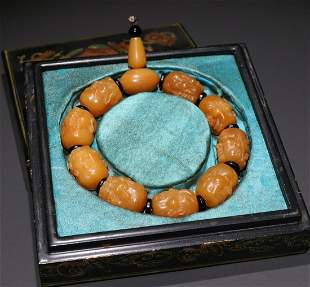 TIANHUANG STONE STRING BRACELET CARVED WITH ARHAT HEAD