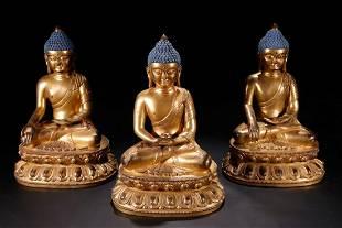 SET OF GILT BRONZE CAST BUDDHA STATUES