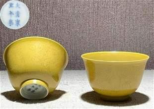 PAIR OF KANGXI MARK YELLOW GLAZE DRAGON CUPS