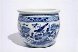 A blue and white Chinese fishbowl with birds among