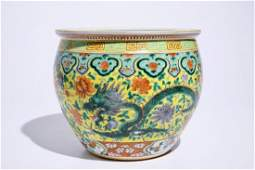 A small Chinese famille verte fish bowl with dragons on