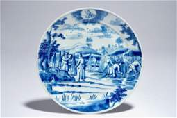 A Dutch Delft blue and white plate with peasants from
