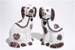 A pair of Staffordshirestyle figures of dogs prob