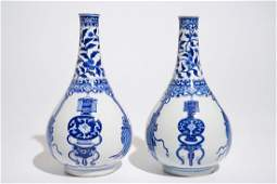 A pair of Chinese blue and white bottle vases, Kangxi