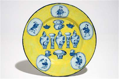 A rare Dutch Delft yellow ground 'Sample' or 'Hundred