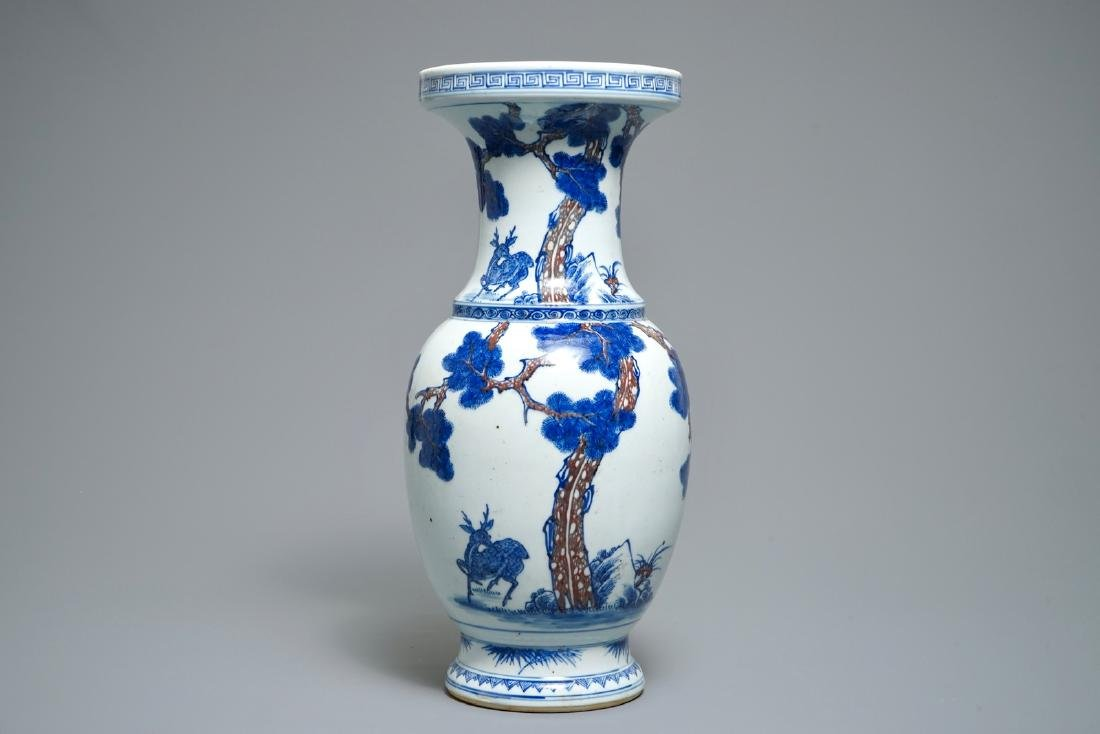 A Chinese blue, white and iron red vase with deer,