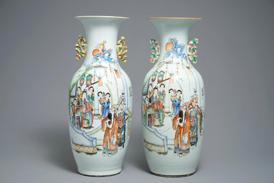 A pair of Chinese famille rose vases with figures on a