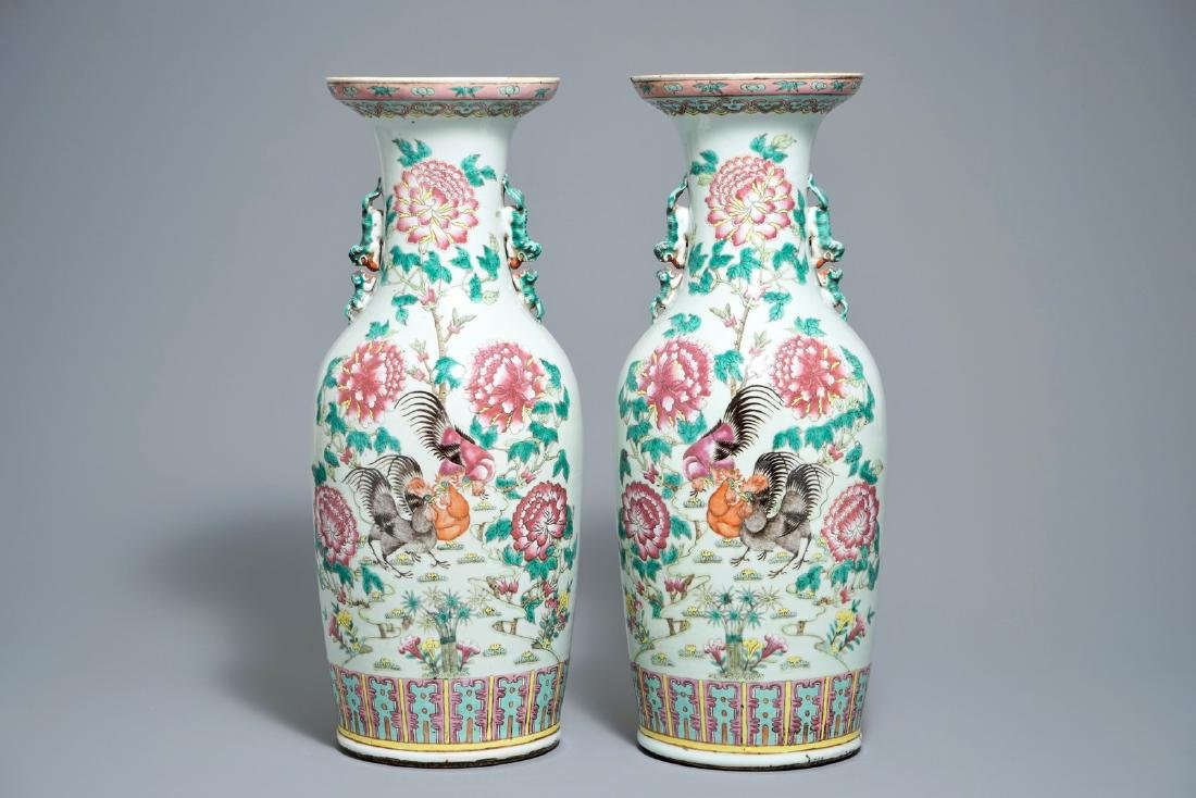 A pair of Chinese famille rose vases with birds among
