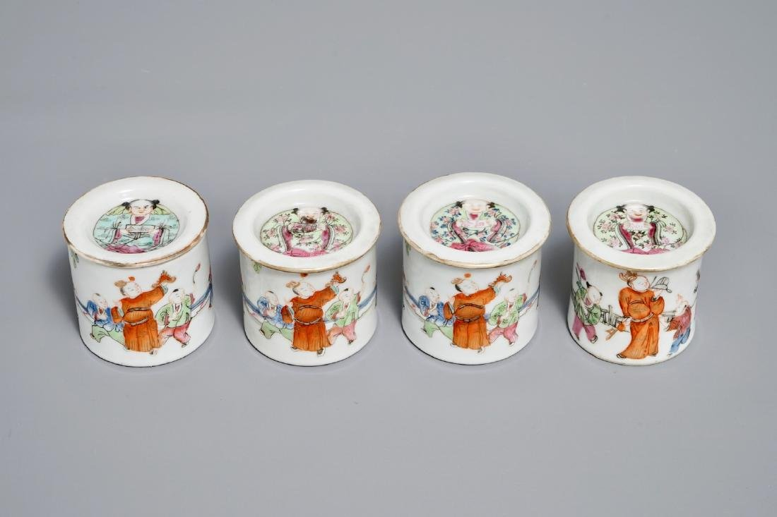 Four cylindrical Chinese famille rose covered boxes,