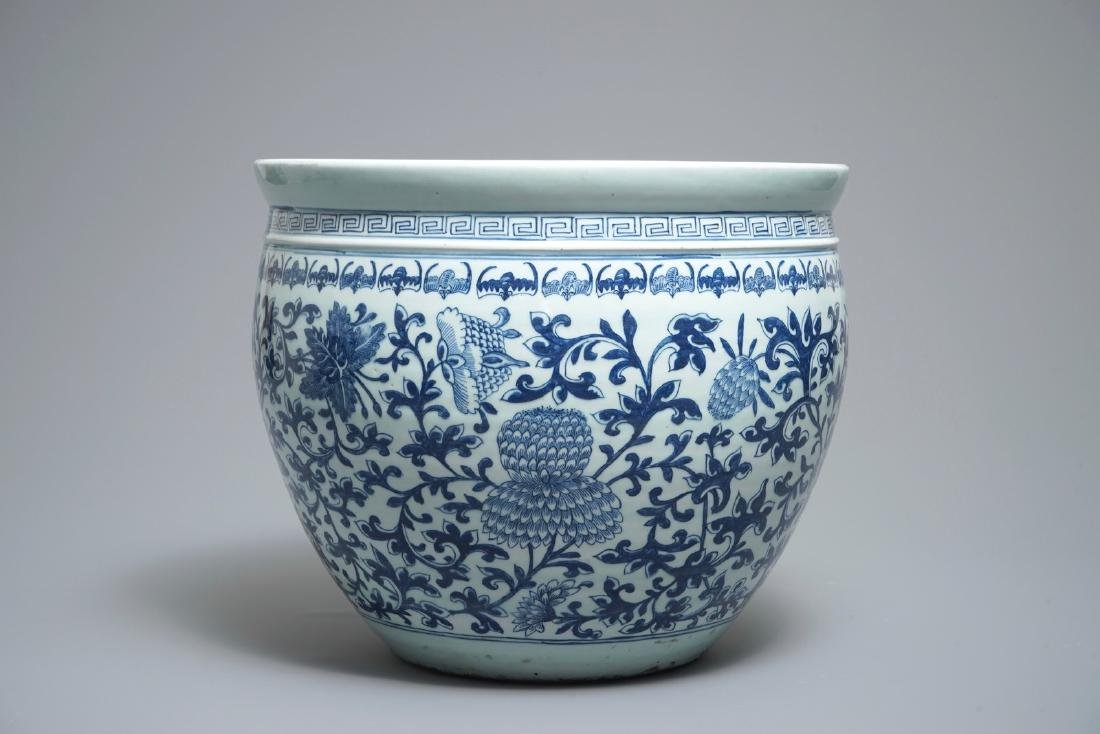 A Chinese blue and white fish bowl with bats and