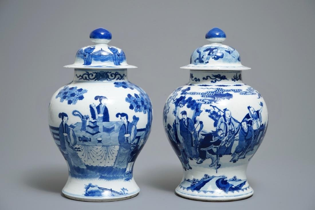 Two Chinese blue and white vases and covers with