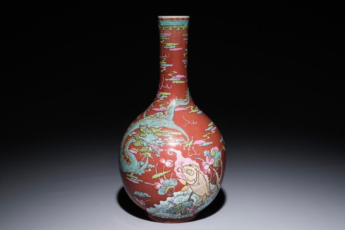 A Chinese oxblood-glazed bottle vase with overglaze
