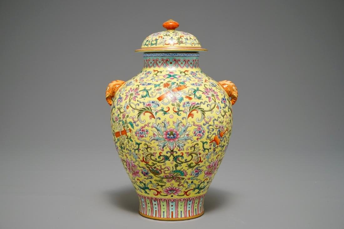A Chinese famille rose yellow-ground vase and cover,