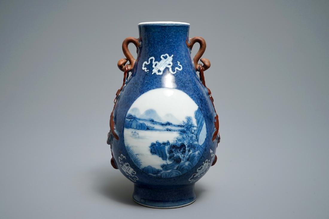 A Chinese blue and white powder blue-ground hu vase