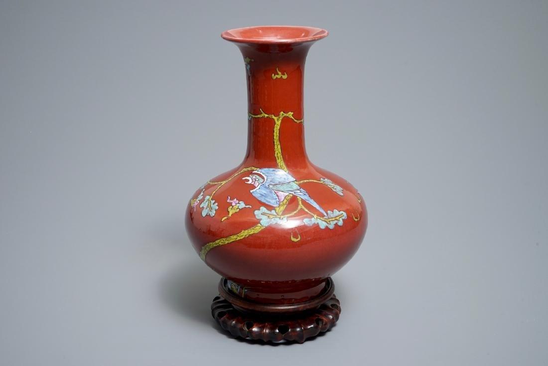 A Chinese oxblood-glazed bottle vase with an overglaze