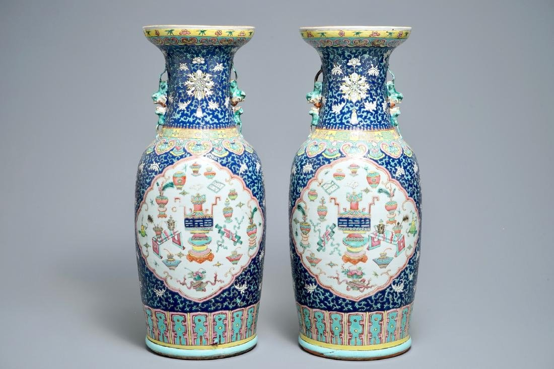 A pair of Chinese famille rose blue-ground vases, 19th