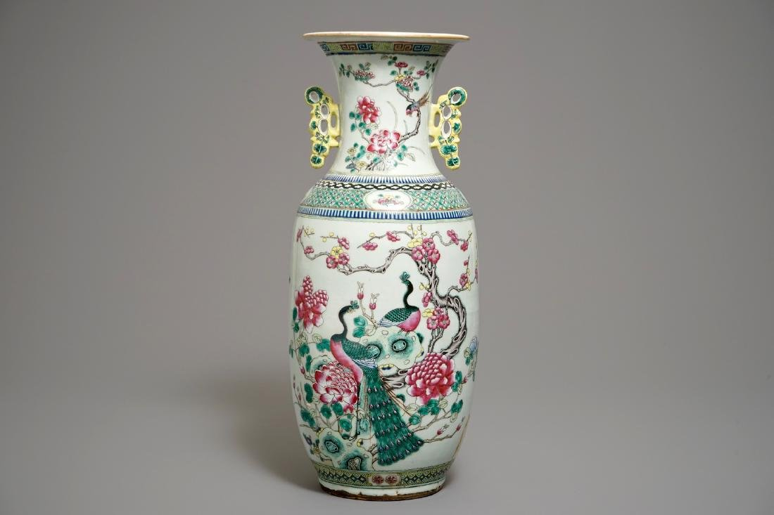 A large Chinese famille rose vase with peacocks and