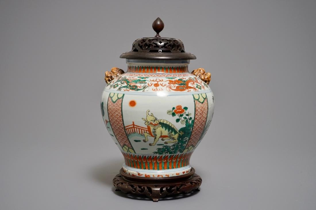 A Chinese wucai vase with mythical beasts, 19th C.