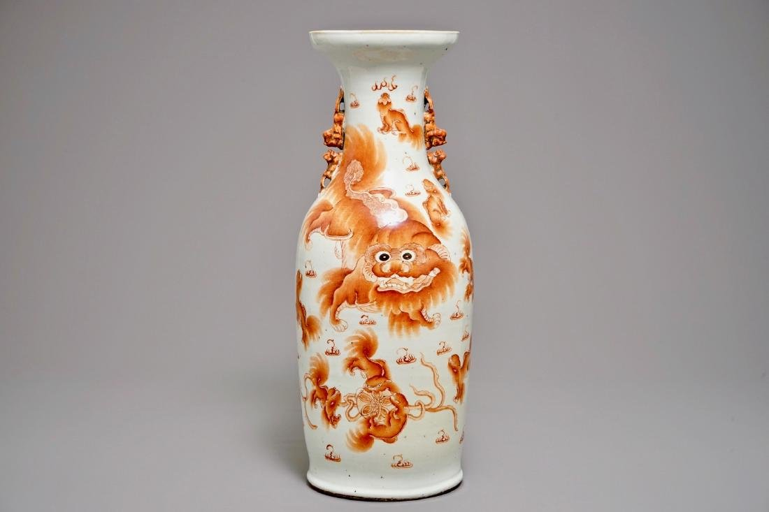 A Chinese iron red vase with Buddhist lions, 19th C.
