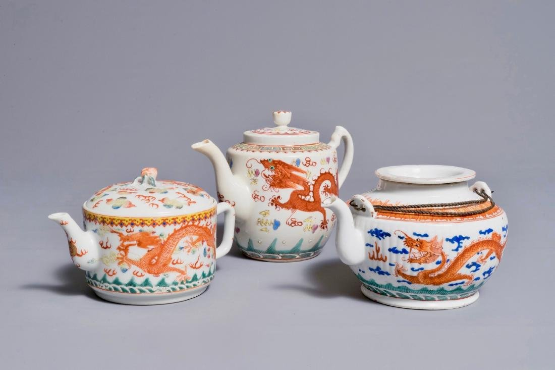 Three Chinese teapots and covers with dragon designs,