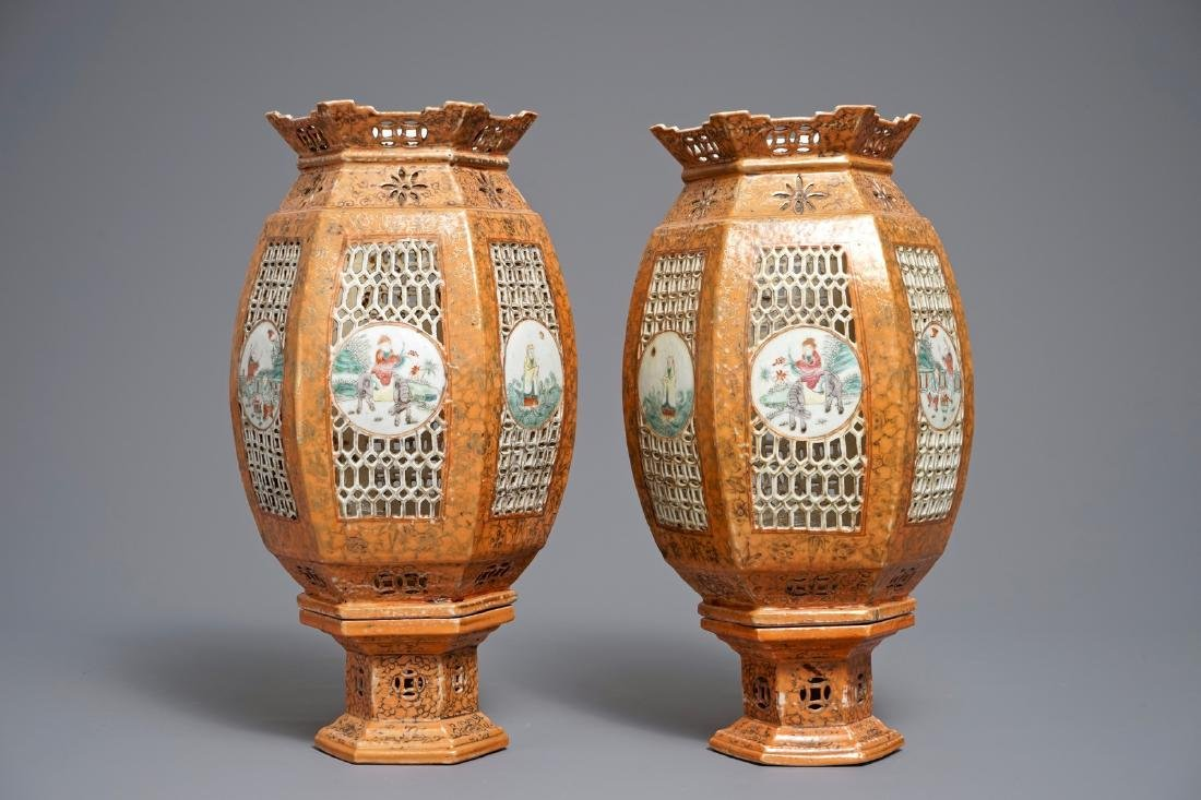 A pair of Chinese famille rose coral-ground lanterns,