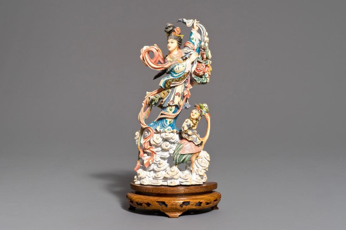 A Chinese polychrome carved  figure of Magu on wooden