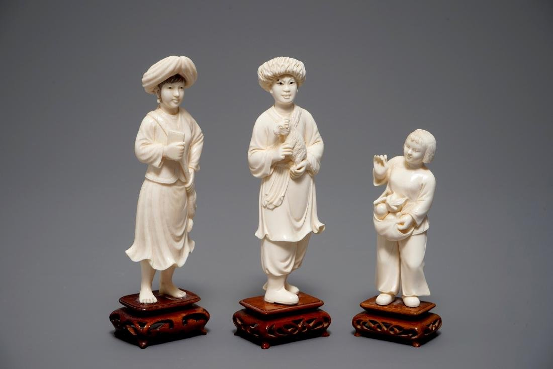 Three fine Chinese carved  figures on wooden bases, 2nd