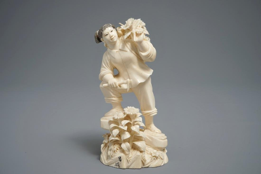 A Chinese carved  model of a girl with a pickaxe, 1st