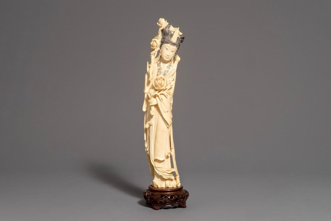 A Chinese carved  figure of a lady on wooden base, 2nd