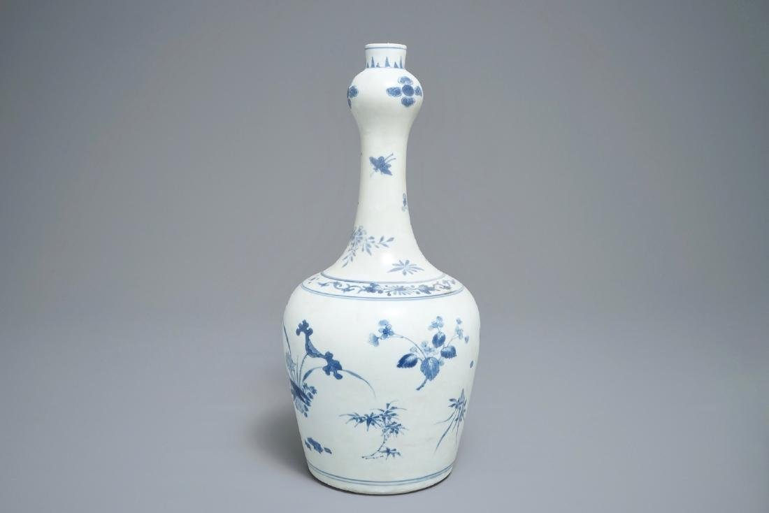 A Chinese blue and white bottle vase with floral