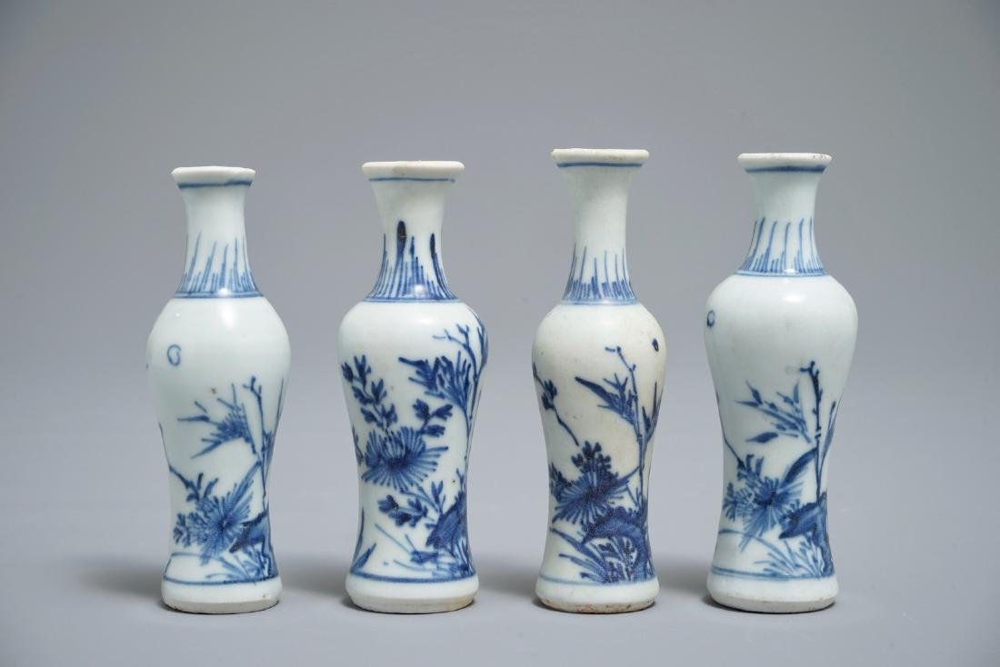 Four Chinese blue and white vases with floral design,