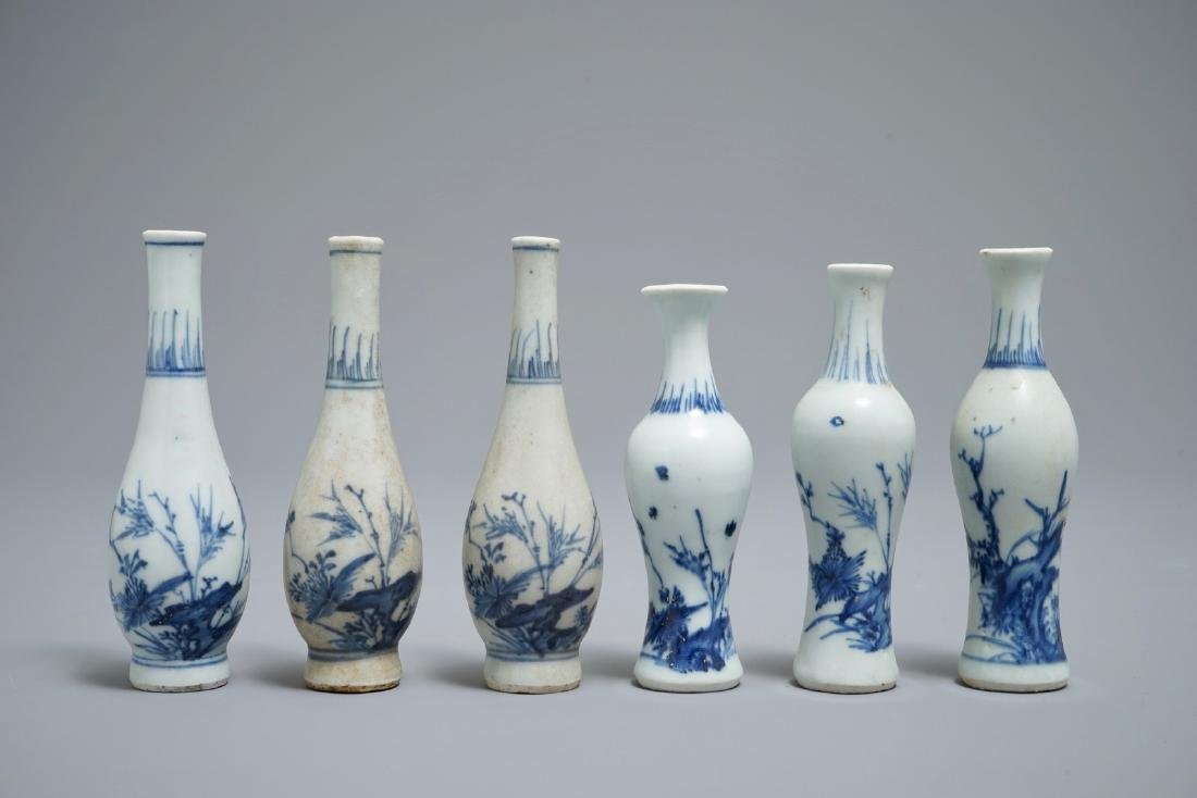 Six Chinese blue and white vases with floral design,
