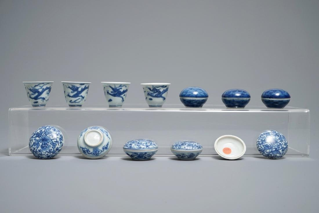 Eight Chinese blue and white covered boxes and four