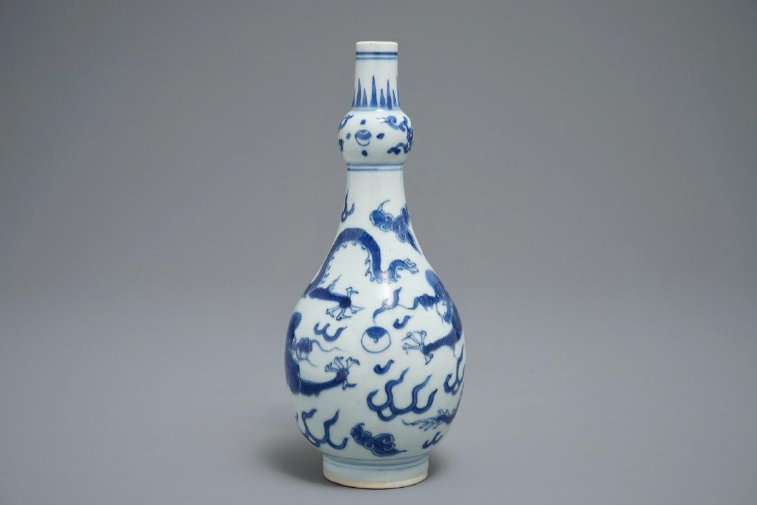 A Chinese blue and white 'dragon' vase, Transitional