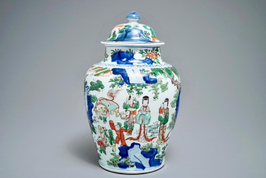 A Chinese wucai baluster vase and cover with figures in