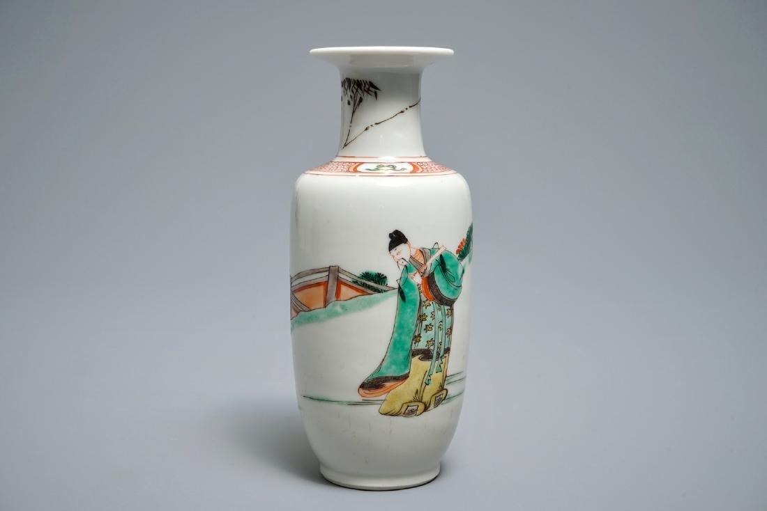 A Chinese famille verte rouleau vase with figures in a