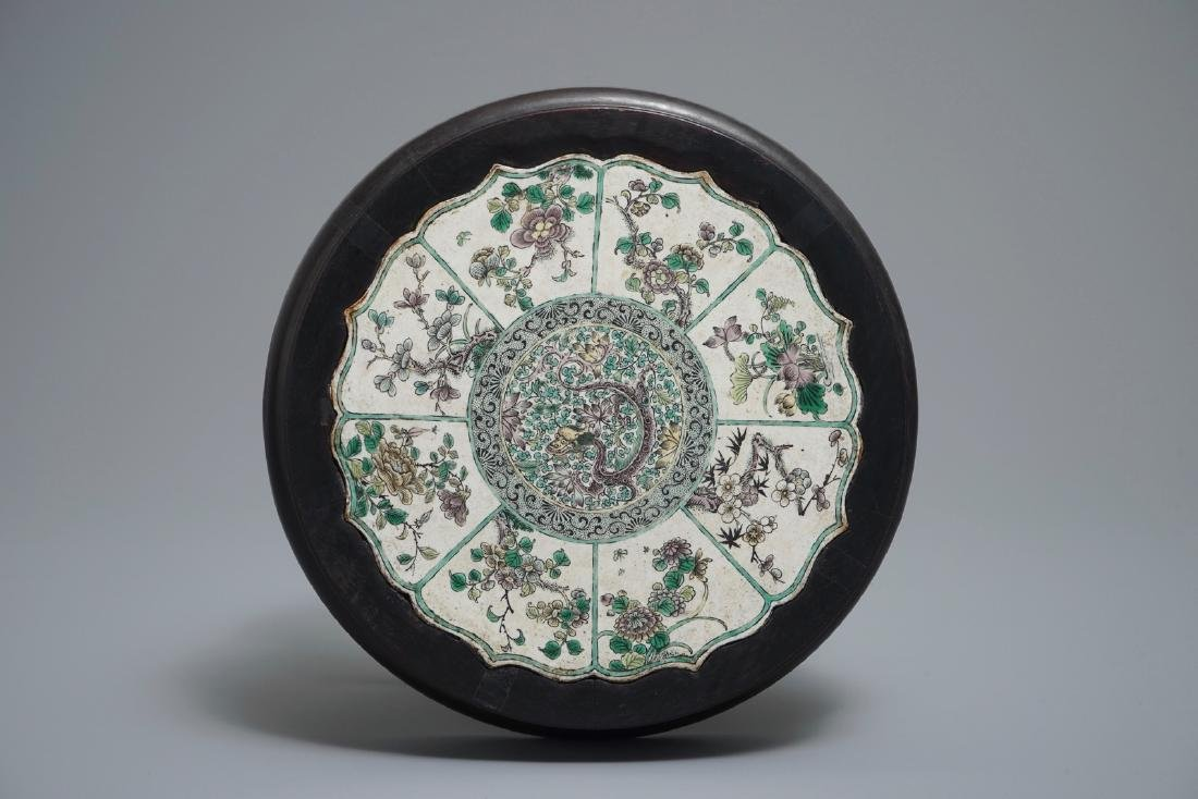 A Chinese verte biscuit lotus-shaped dragon plaque