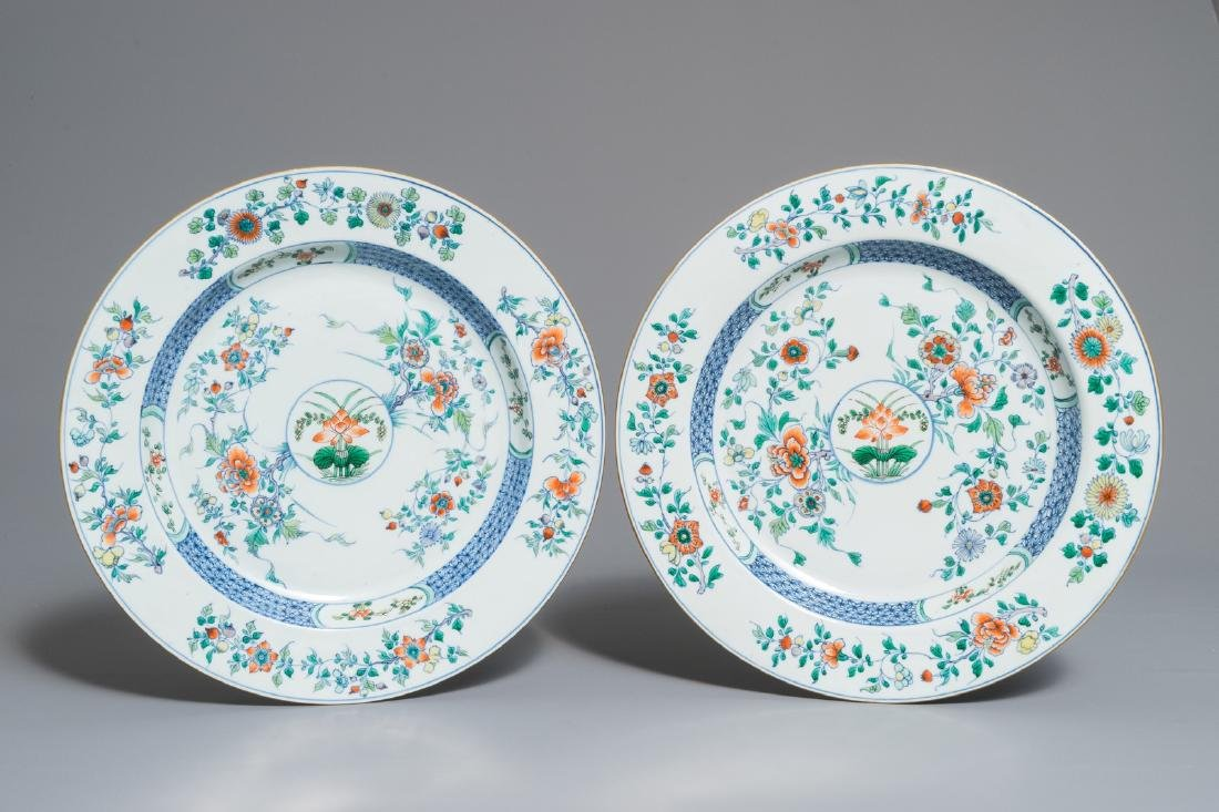 A pair of Chinese doucai chargers with floral design,