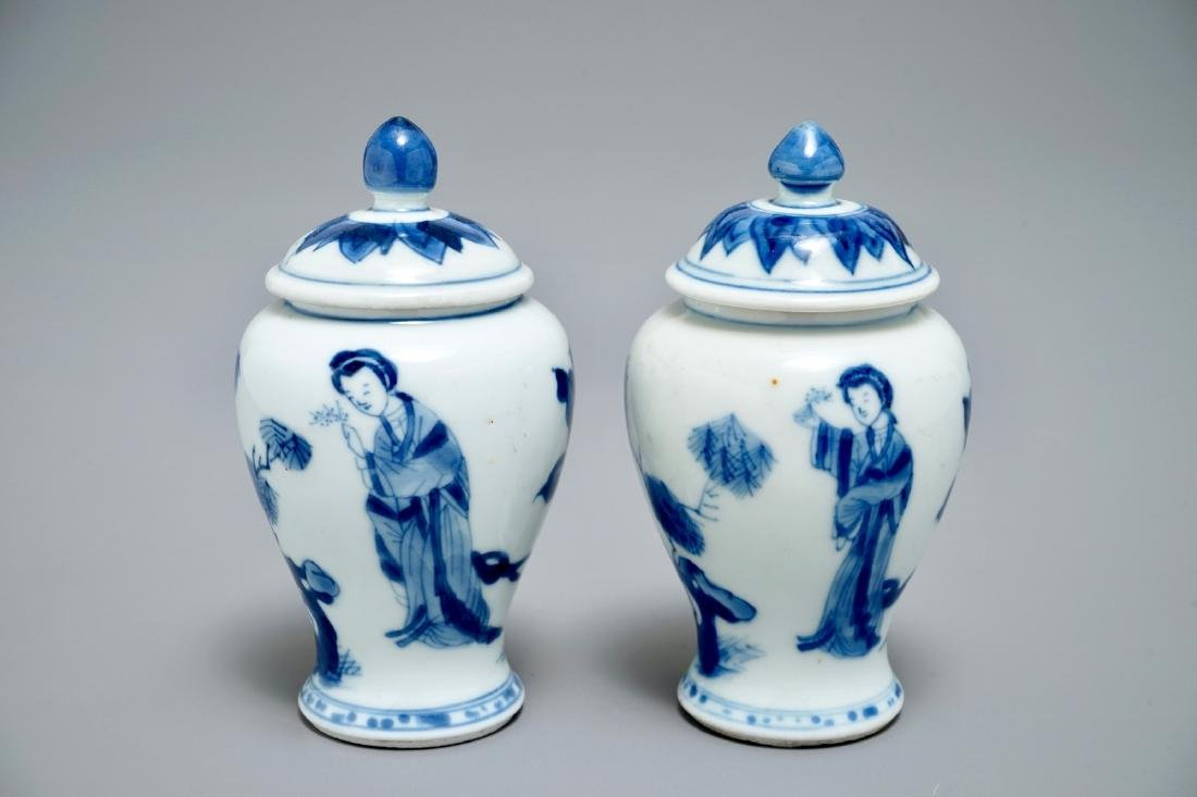 A pair of Chinese blue and white miniature vases and